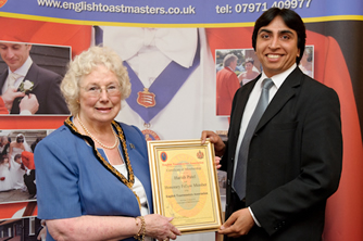 Harish Patel receiving his Honorary Fellow membership certificate from the Chairman of Essex County Council, Councillor Elizabeth Hart at the County Hotel, Chelmsford