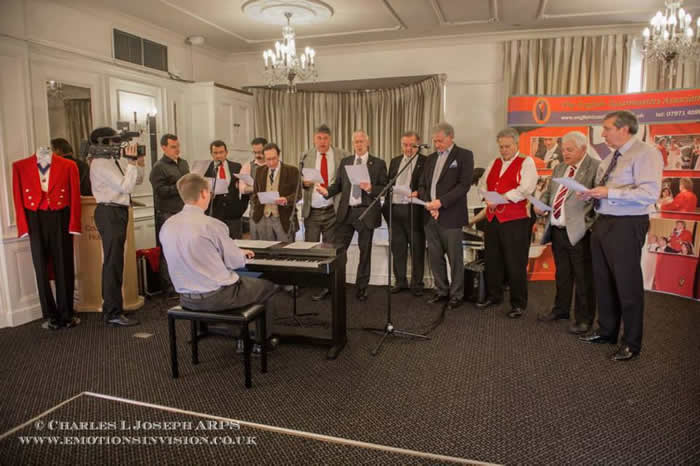 English Toastmasters Association choir practice for the Masonic Ladies Song