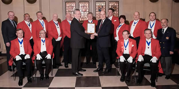 Hon. Fellow of the English Toastmasters Association Patrick Stevenson receiving his fellowship certificate from Lord of the Manor of Romans Fee, Writtle, Essex, Richard Oscroft MBE