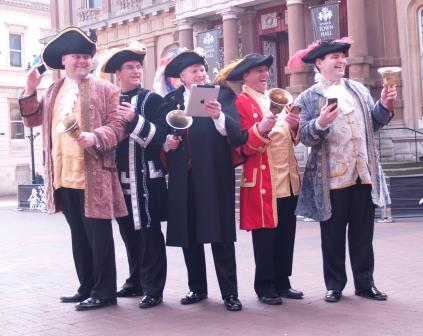Town Criers form the English Toastmasters Association ringing the changes for new methods of communications.