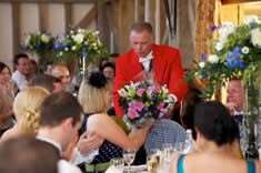 Kent wedding toastmaster delivering flowers to a wedding guest