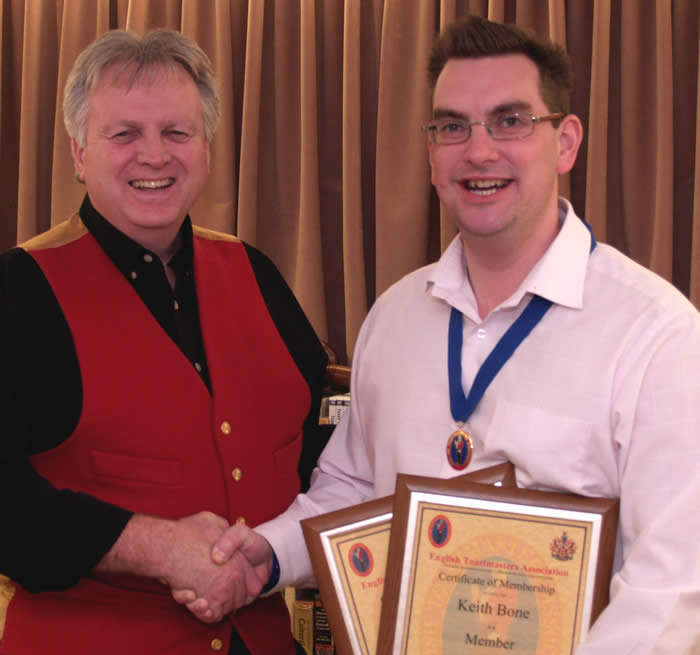 Toastmaster training course completed, London Toastmaster Keith Bone receiving his certificates for training and membership of The English Toastmasters Association