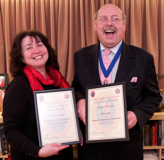 Toastmaster Roger Round receiving his training certificates from Linda Palmer, founder member of the English Toastmasters Association