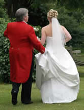 Essex wedding toastmaster Richard Palmer assisting the bride with her wedding dress at the Park Hotel, Lakeside, Essex